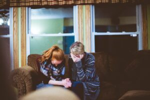 women consoling each other through grief and loss
